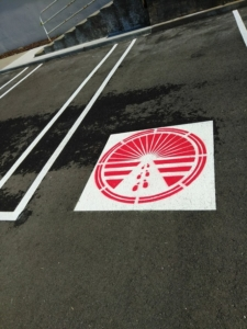 Painting Logo Striping on Detroit Metro Parking Lot Michigan